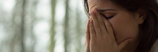 Sad girl crying during visit at psychologist