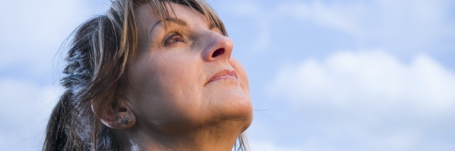 mature woman look in the sky