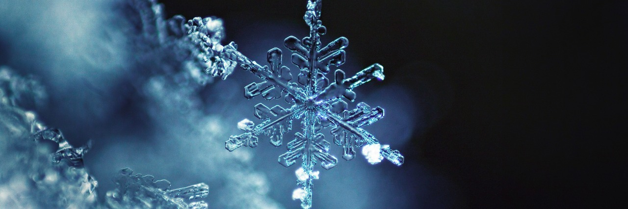 snowflake in front of black background