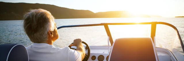 A man driving a boat