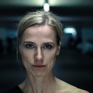 Night portrait of an intense middle-aged blond woman