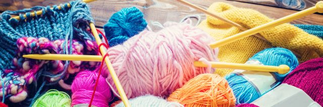 Knitting needles and wool.