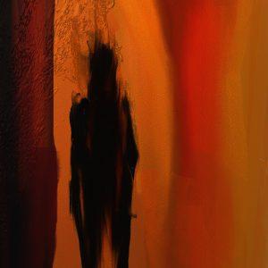 A blurry dark figure of a person