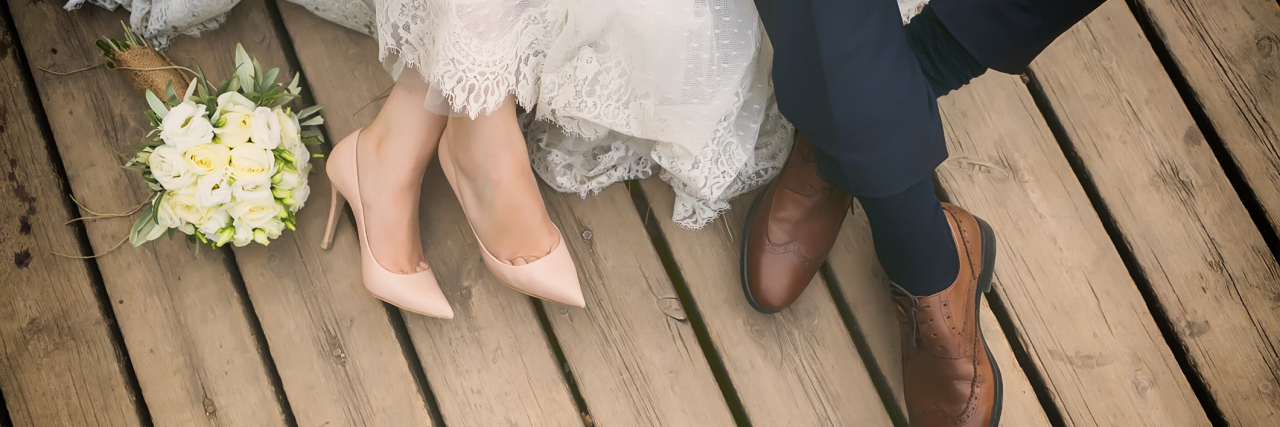feet of bride and groom, wedding shoes (soft focus). Cross processed image for vintage lookfeet of bride and groom, wedding shoes (soft focus)