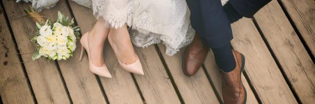 feet of bride and groom, wedding shoes (soft focus). Cross processed image for vintage lookfeet of bride and groom, wedding shoes (soft focus)
