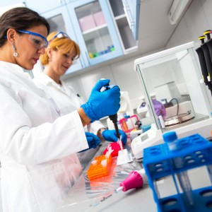 Photo of female scientists researching in laboratory.