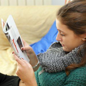 girl reading a women's magazine