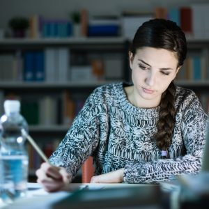 Young woman doing homework