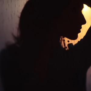 dark profile of a woman at sunset
