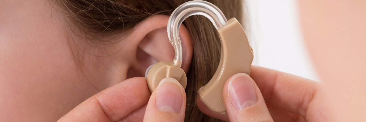 Girl getting a hearing aid.