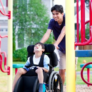 Boy in wheelchair at the playground.