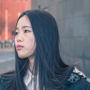 Young beautiful Chinese girl with headphones