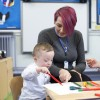 Boy with Down syndrome in preschool.