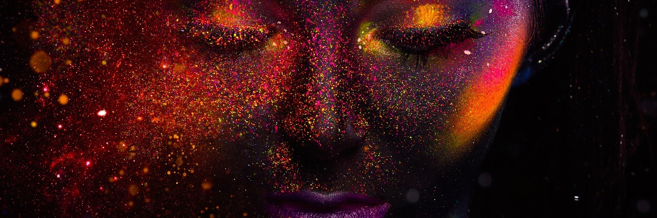 Bright neon make-up, creative body art on the theme of space and stars