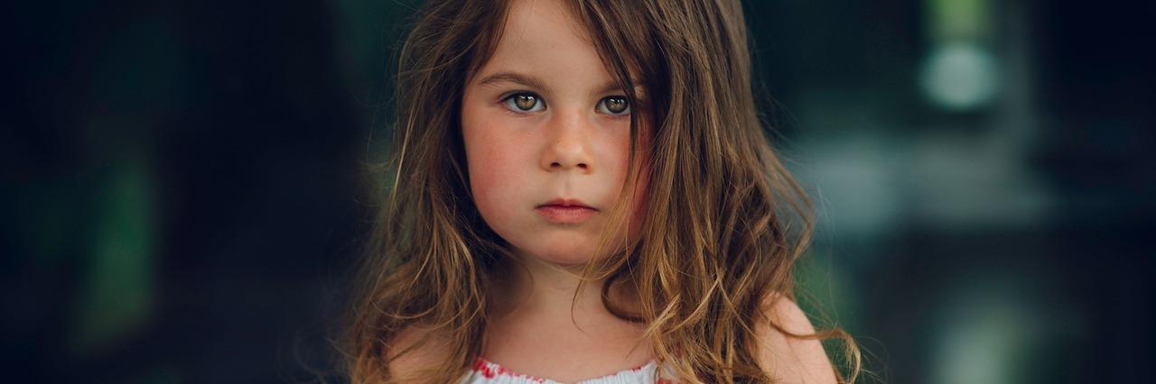 young girl staring forward