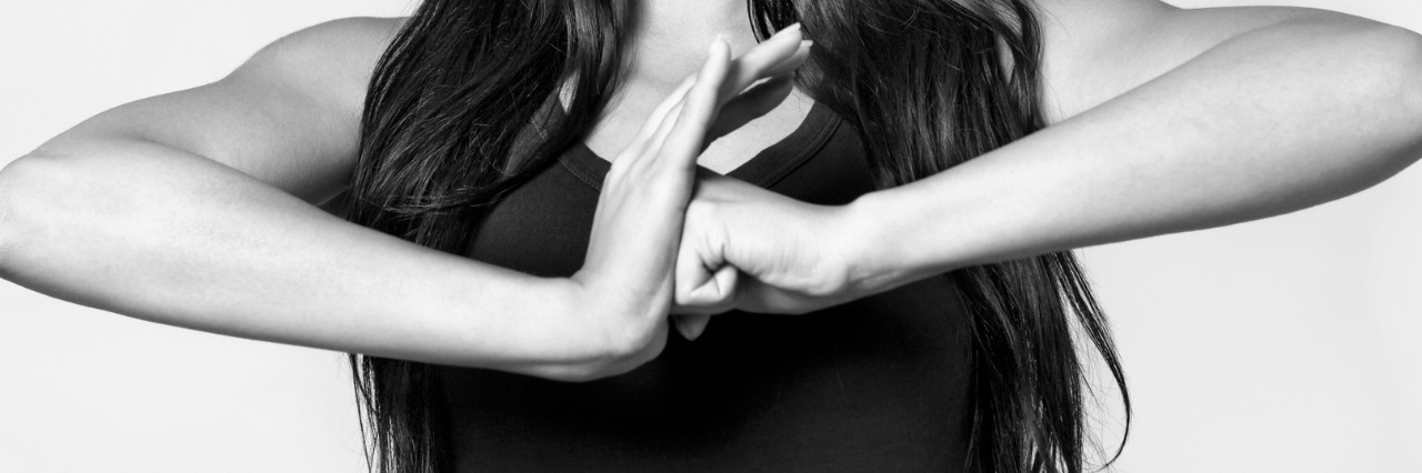 black and white image of woman making a fist