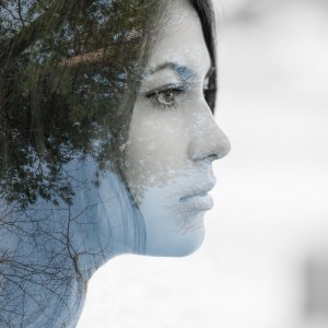 Girl in profile. Double exposure of young woman and forest.