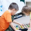 Brother and sister playing together, siblings play home on chess