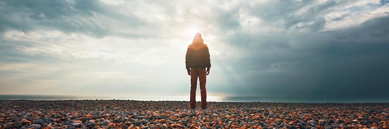 a man standing on rocks