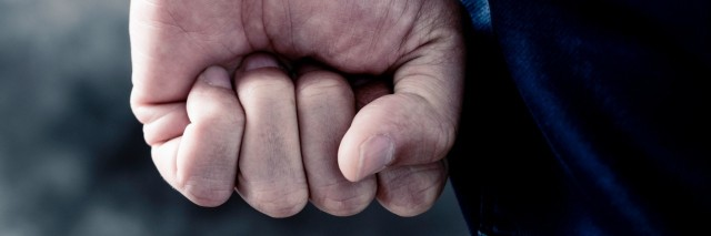 young man clenching his fist