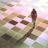 A woman walking on a checkered floor