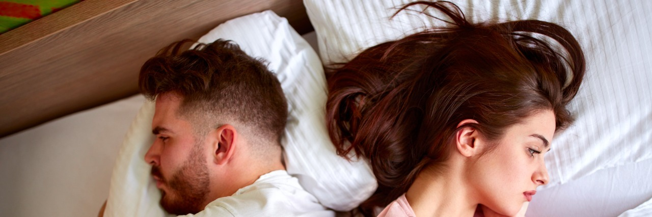 Couple with problems in relationship in bed