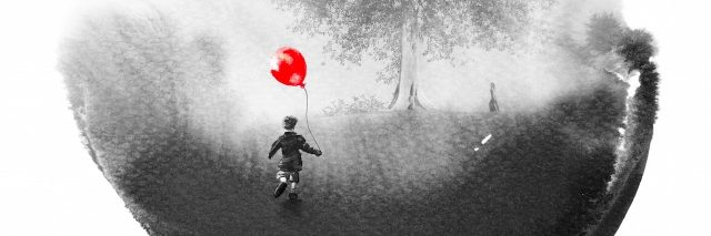 An image of a small child holding a balloon