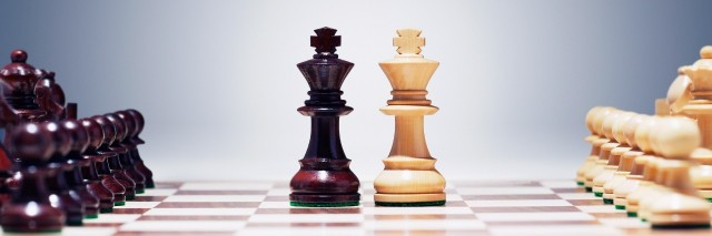 chess board with king pieces next to each other