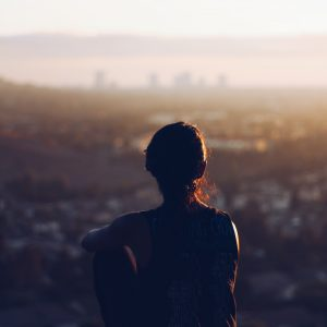 woman looking at los angeles skyline