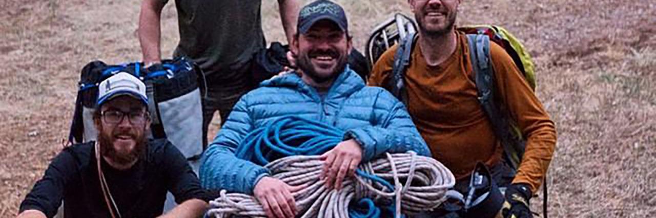 Enock with his climbing team.