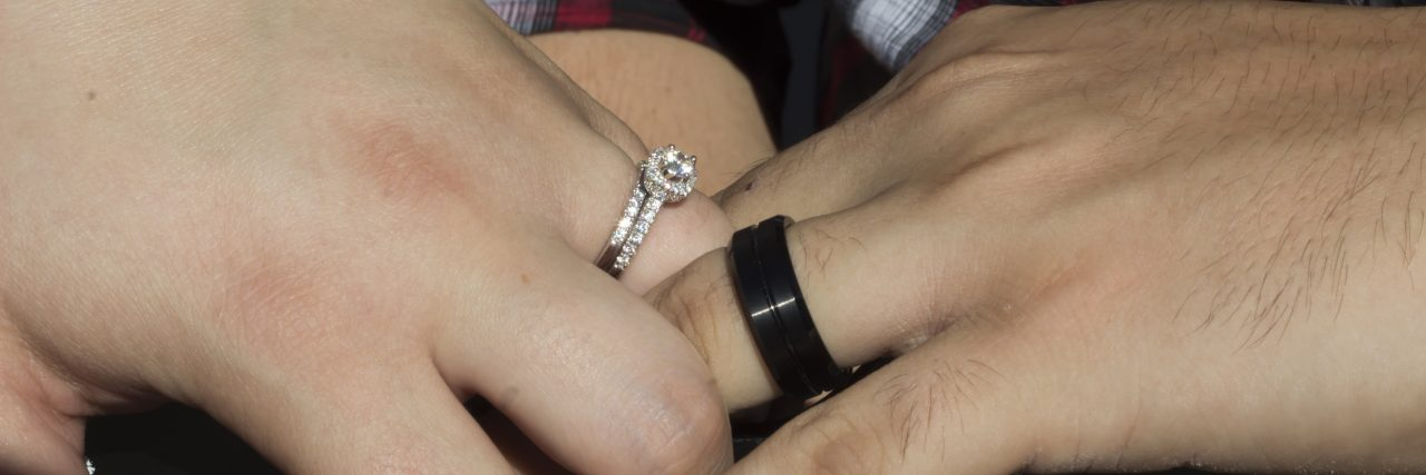 hands showing wedding bands
