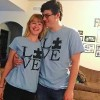 The author and her partner wearing shirts that say [love] with the o as a puzzle piece