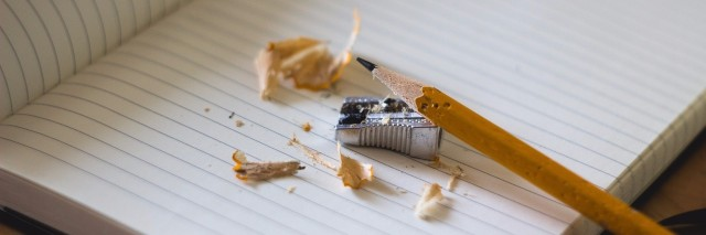 pencil with shavings and sharpener on lined notebook