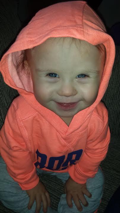 Baby boy wearing hoodie, smiling