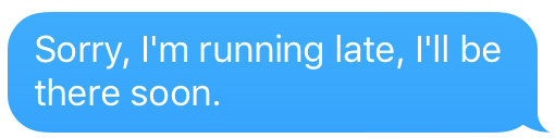 text that says im running late, be there soon