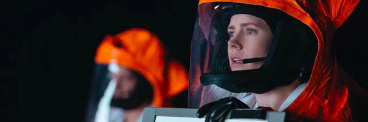 still from arrival movie with amy adams in orange space suit