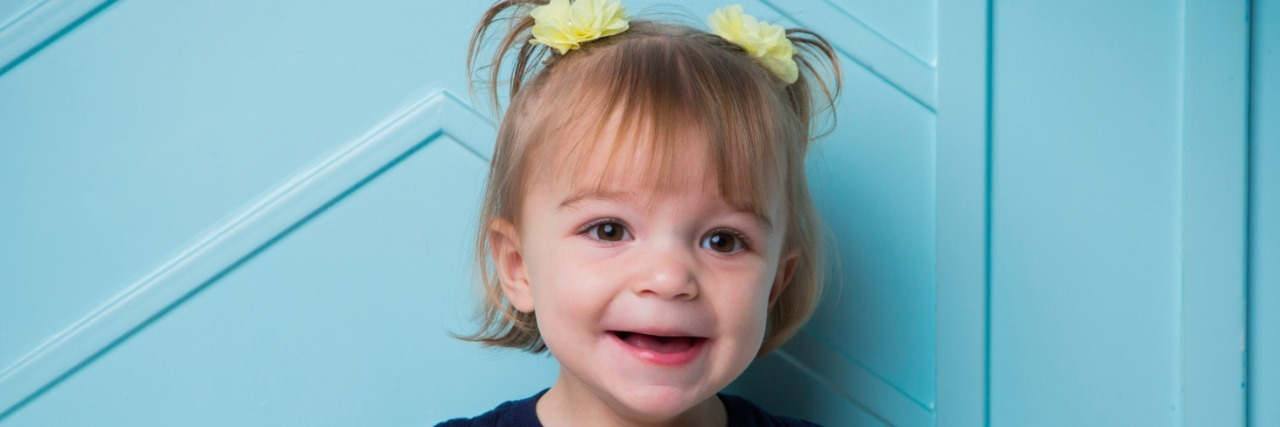 smiling little girl with shank2 gene mutation