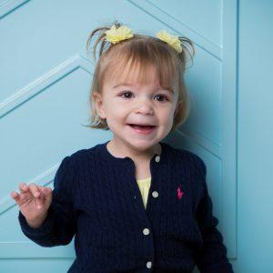 smiling little girl with shank2 gene mutation