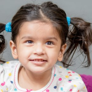 little girl with pig tails