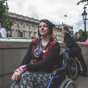 Nina outside in her wheelchair.