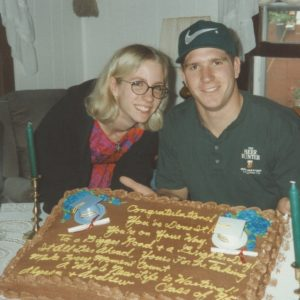 image of contributor and twin brother Andrew with celebration cake