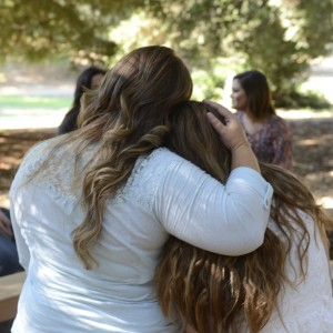 Back view of two girls hugging each other