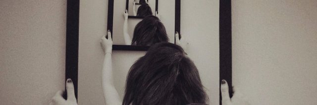 multiple reflections of woman in a mirror
