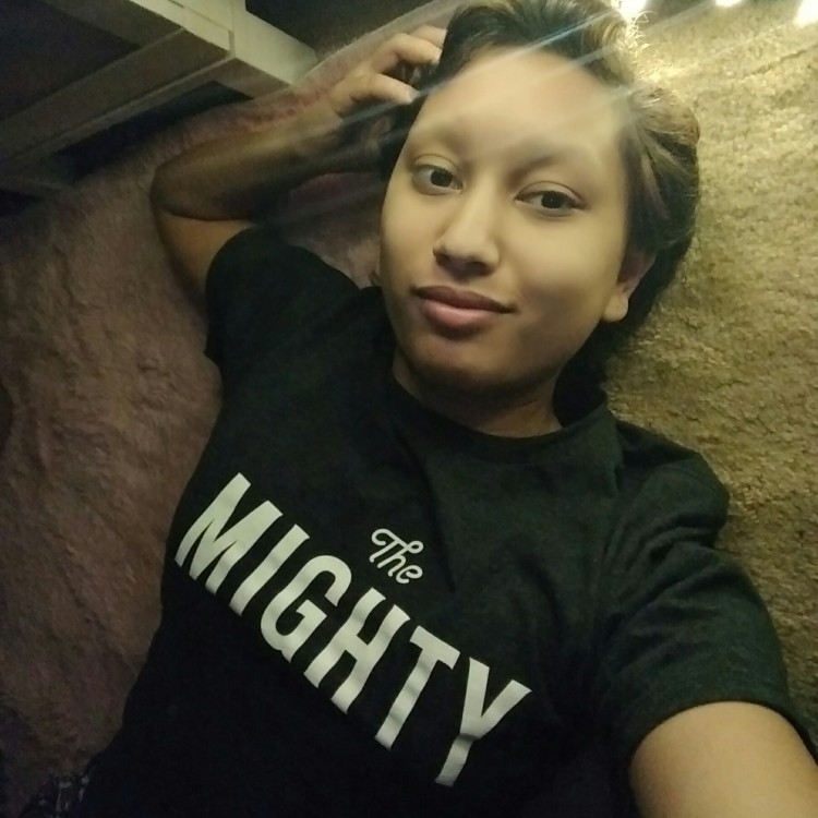 woman wearing Mighty t-shirt posing for camera
