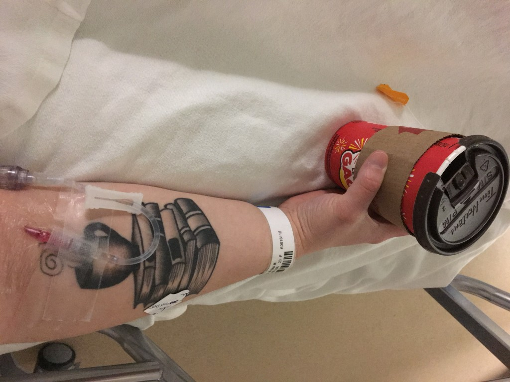patient holding coffee cup in psych ward with tattoo on arm