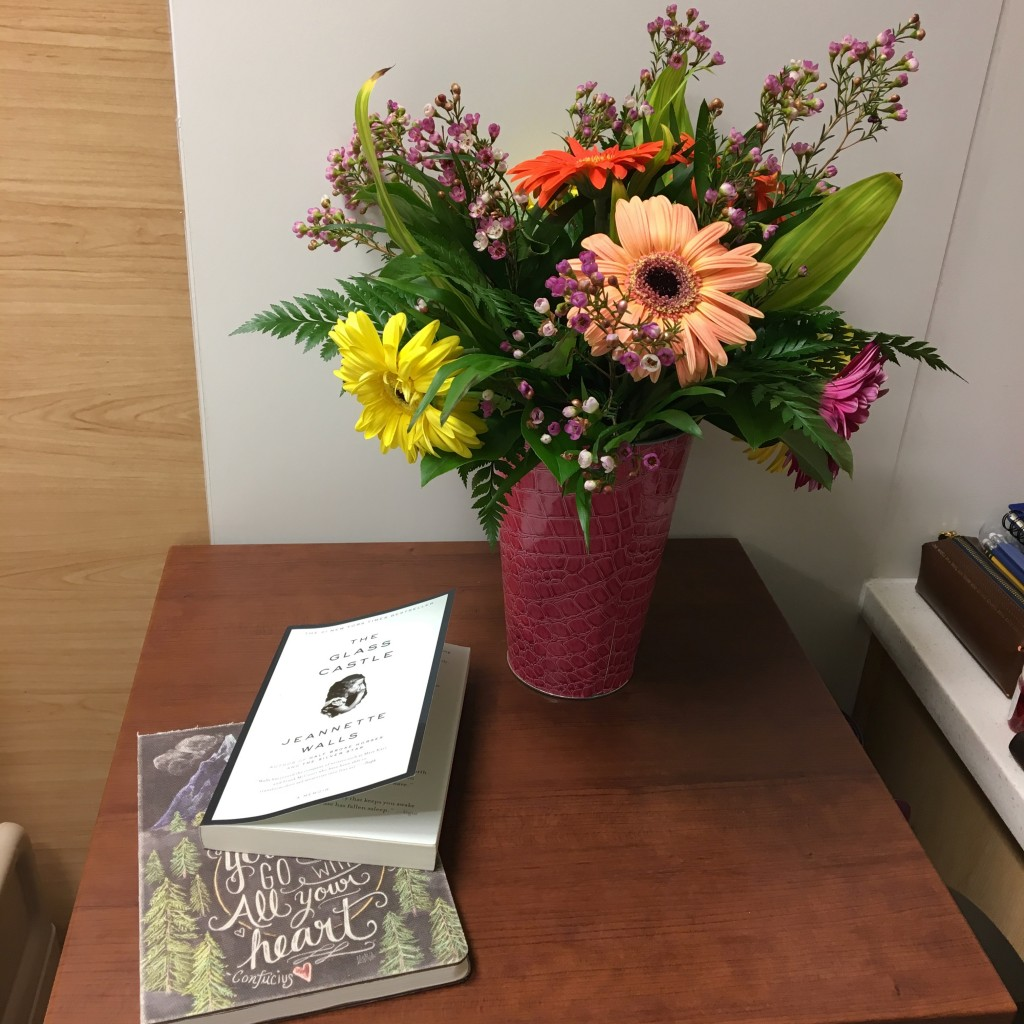 patient's table in psych ward with books and flowers