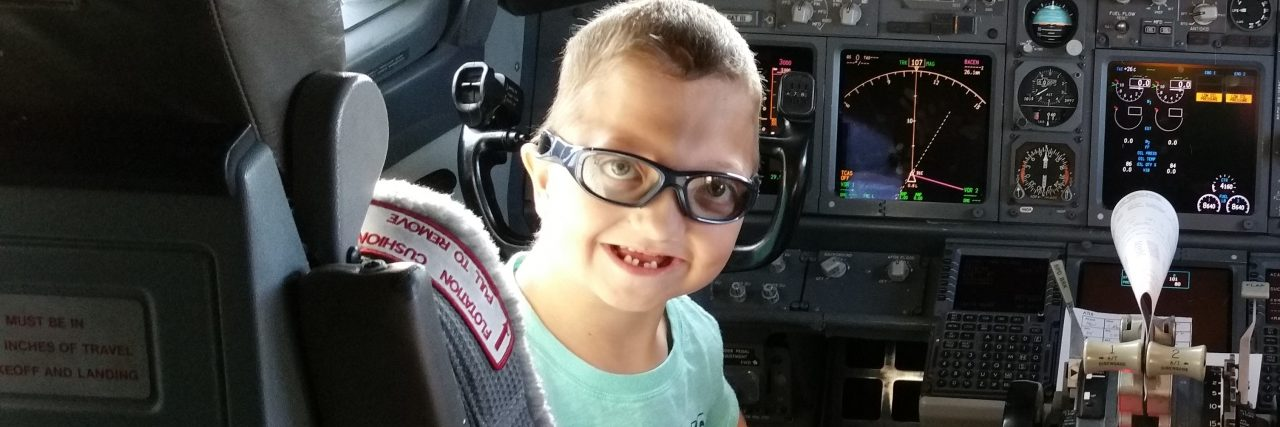 """""""Little Levi"""" Krystosek tours the cockpit before his Miracle Flight."""