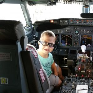 """Little Levi"" Krystosek tours the cockpit before his Miracle Flight."