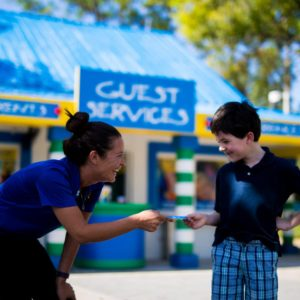 Legoland employee talking to a young boy.