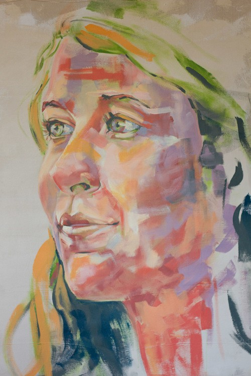 Colorful painting of a woman's face.